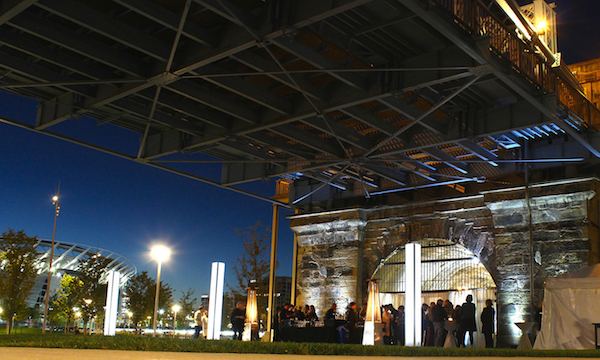 A glamorous opening weekend reception on the waterfront, underneath the Roebling Bridge.