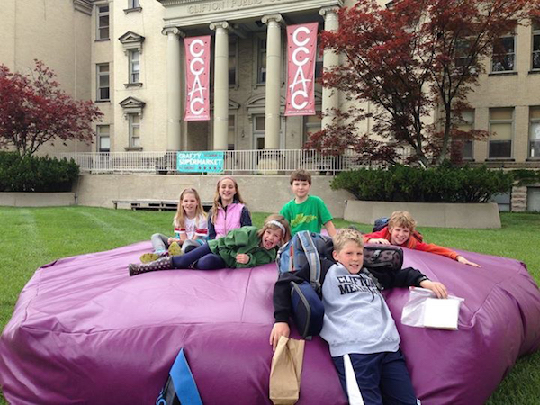Earlier this year, kids enjoy Plop! in front of the Clifton Cultural Arts Center.