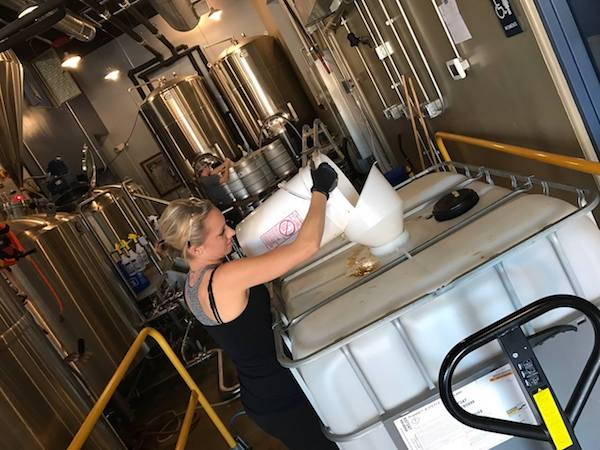Katrina Eckard, CEO of WEL Enterprises, works on the water reclamation system at Municipal Brew Works.