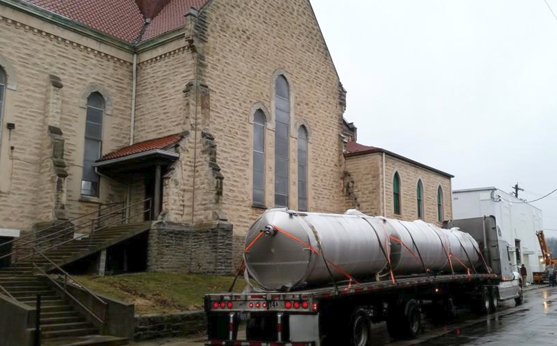 Brewing tanks arrive at the former St. Patrick's Church