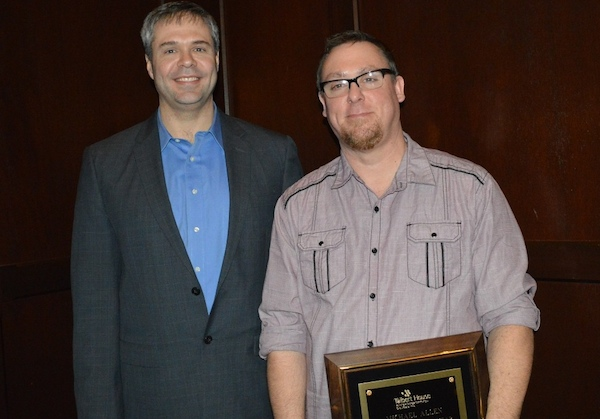 Michael Allen (right) accepts Employee of the Year from Talbert V.P. Brad McMonigle