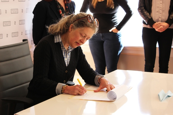 Nancy Sunnenburg signs her Project Grant contract April 24
