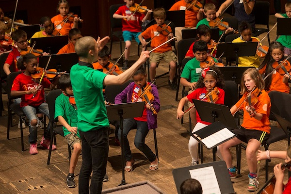 Eddie Kwon conducts the MyCincinnati youth orchestra, based in Price Hill