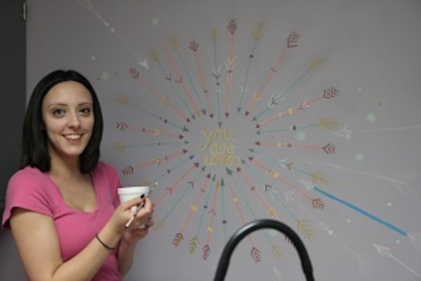 UC fine arts student Jordan Stephens helps spruce up the Price Hill Health Center