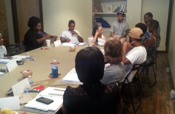 Mike Brown, owner of Brown Lawn Care, takes notes (center) during Mortar's weekly meeting of its new startup class