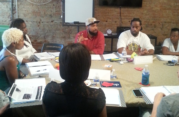 Mortar co-founder Allen Woods (center) speaks with the accelerator's startup class in Over-the-Rhine