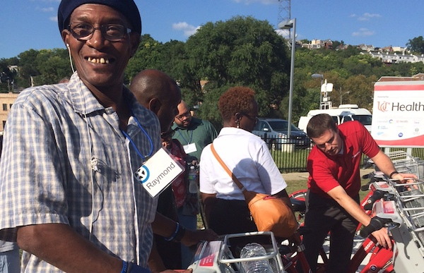 Red Bike's Jason Barron (right) provides pointers to CityLink members
