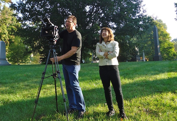 Andrea Torrice and videographer Dave Morrison on location in Spring Grove Cemetery