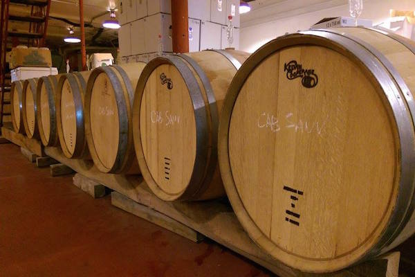 Barrels age in Revel OTR's basement cellar
