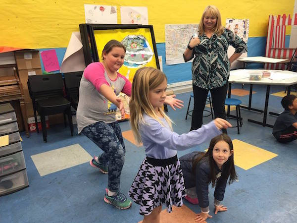 A group of kids in one of last year's ArtStop Artist Series workshops learned how to communicate through dance.