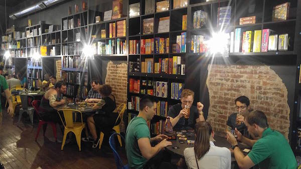 Customers enjoy a draft and something to eat over board games at The Rook OTR.