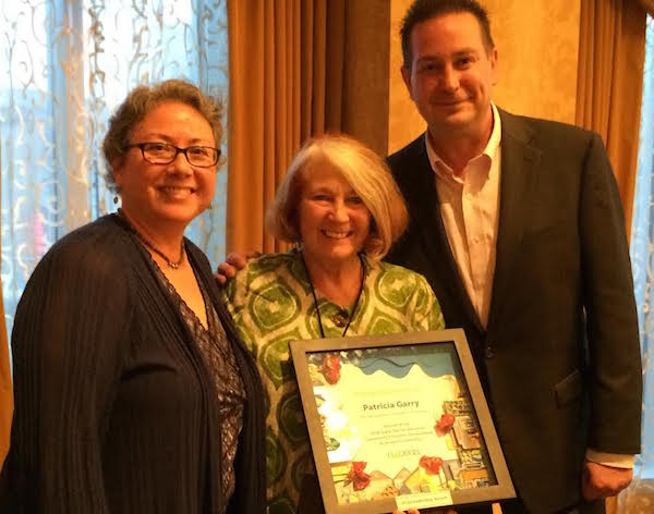 Patricia Garry (center) receives the 2016 national award for community development leadership from NACEDA Chair Sharon Legenza and Ohio CDC Association Executive Director Nate Coffman.
