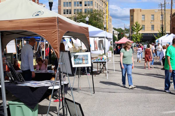 Artists set up in tents along Seventh Street during last year's Art Off Pike.
