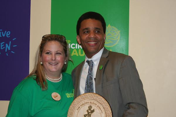 Mary Huttlinger awards Councilmember Christoper Smitherman the Golden Glove award.