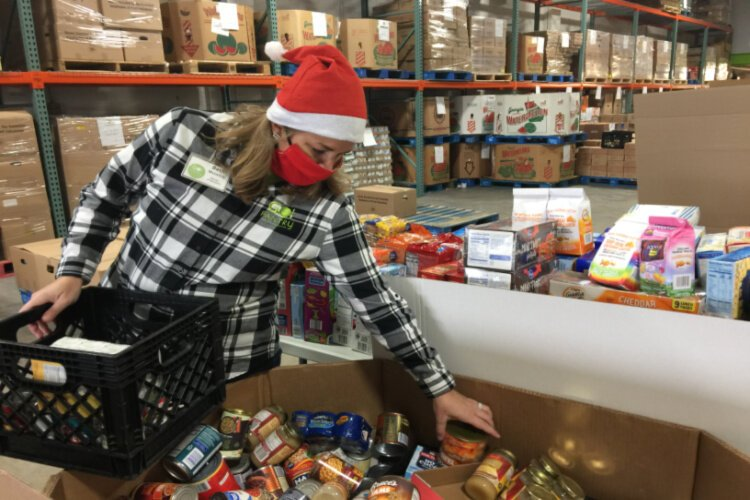 Beth McIntire sorts donations at a GO Pantry food collection event.
