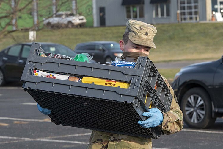 Kentucky National Guard members helped distribute food at Action Ministries in Latonia in December.