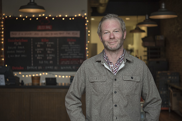 Elias Leisring of popular Eli's BBQ will partner to bring a bouldering gym to downtown.