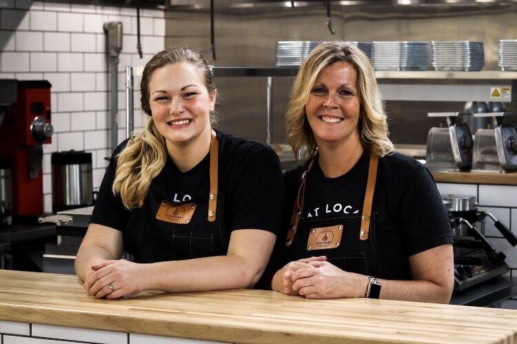 Marcy Nesselroade (right) owns Ironworks Waffle Cafe in COhatch The Market in Springfield and runs the business with her daughter Ellie Morgan (left).