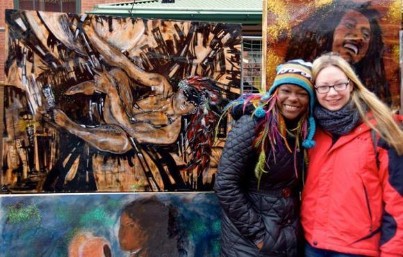 Quest Skinner (left) and her artwork in Washington, D.C.