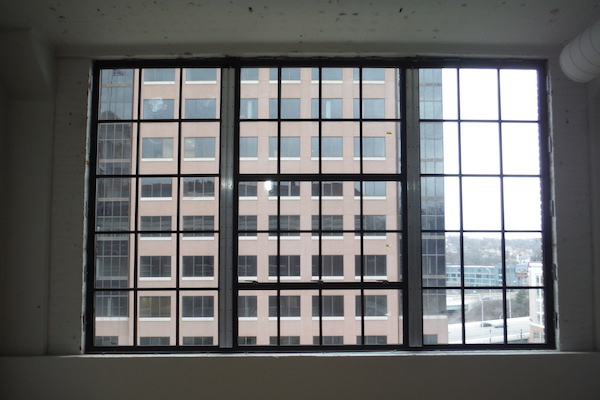 Windows on the upper floors were historically restored, but with paned glass.