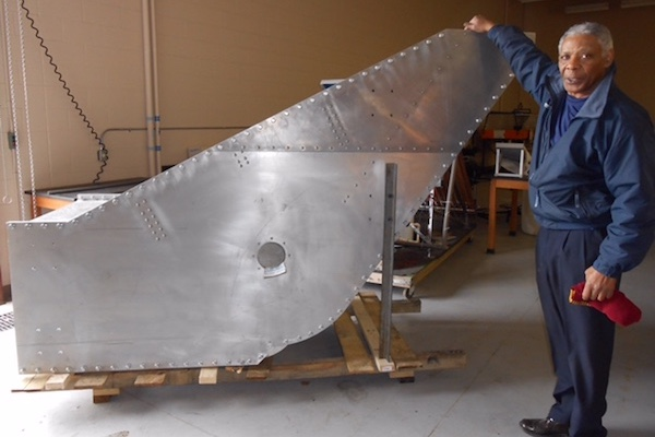 Fred Williams stands with his design, the Williams Cross-Flow Turbine.