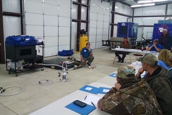 WaterStep leads a rural water training workshop, featuring its mini water chlorination plant.