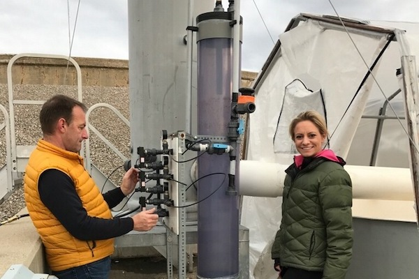 WEL Enterprise CEO Katrina Eckard with her water reclamation system. WEL is a member of Pipeline's first class.