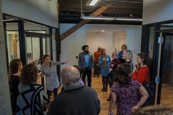 Attendees at the Center for Great Neighborhoods in Covington, one of three tour stops at last year's IDEALAB.