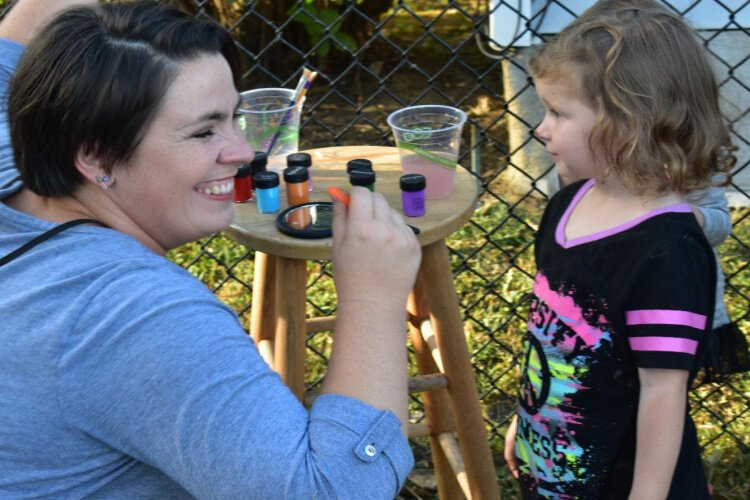 A rebuilt Peaselburg Park was dedicated with a day of activities including face painting.