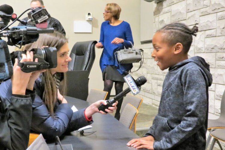 Dante Hall Jr. participated in the celebration at Erlanger City Hall and was  interviewed by local media.