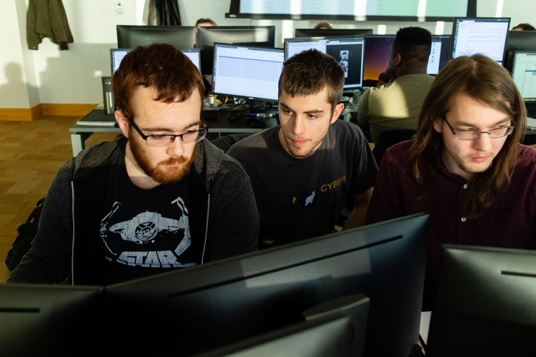 In the JRG Cyber Threat Intelligence Lab are Zeb Gentry, Bradley Hatting, and Justin Flynn.